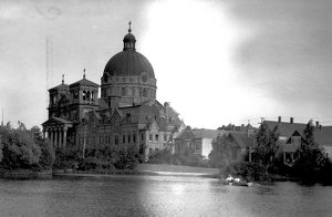 This photograph from around 1920 shows the Basilica from the lagoon in Kosciuszko Park.