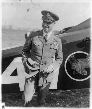Standing portrait of Billy Mitchell in front of a plane at Bolling Field in 1925. He ranked as a colonel at the time.