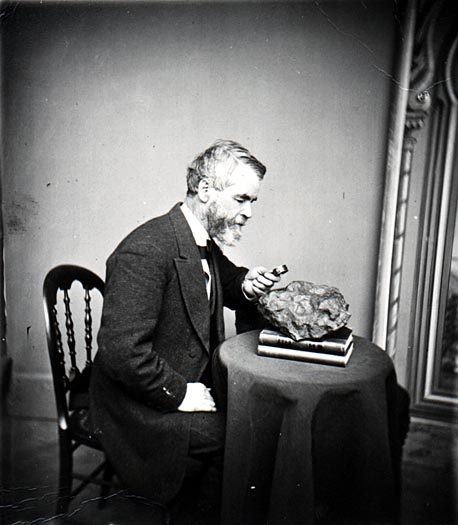 Increase Lapham examines a meterorite that had fallen in Wisconsin, circa 1868.