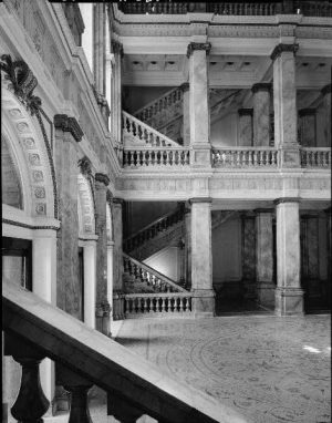 Photograph featuring a staircase and columns inside the Milwaukee Public Library, now the Central Branch, circa 1933.