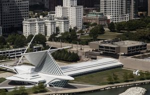 Photograph featuring an aerial view of the Milwaukee Art Museum with its famous wings open.