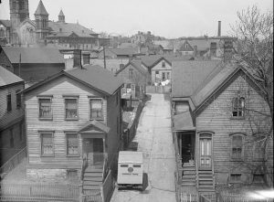 This 1936 photograph shows the alley at 1012 West Somers Street.