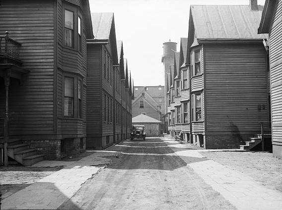 <table class=&quot;lightbox&quot;><tr><td colspan=2 class=&quot;lightbox-title&quot;>Looking Down an Alley</td></tr><tr><td colspan=2 class=&quot;lightbox-caption&quot;>This April 1936 photograph shows the unpaved alley at 730 West Winnebago Street. </td></tr><tr><td colspan=2 class=&quot;lightbox-spacer&quot;></td></tr><tr class=&quot;lightbox-detail&quot;><td class=&quot;cell-title&quot;>Source: </td><td class=&quot;cell-value&quot;>From the Library of Congress Farm Security Administration - Office of War Information Photograph Collection.<br /><a href=&quot;https://www.loc.gov/item/2017761473/&quot; target=&quot;_blank&quot;>Library of Congress</a></td></tr><tr class=&quot;filler-row&quot;><td colspan=2>&nbsp;</td></tr></table>