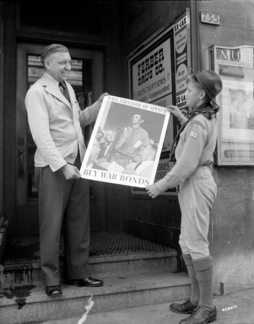 <table class=&quot;lightbox&quot;><tr><td colspan=2 class=&quot;lightbox-title&quot;>Boy Scout During World War II</td></tr><tr><td colspan=2 class=&quot;lightbox-caption&quot;>A Boy Scout helps display a poster promoting the purchase of war bonds in this 1943 photograph.</td></tr><tr><td colspan=2 class=&quot;lightbox-spacer&quot;></td></tr><tr class=&quot;lightbox-detail&quot;><td class=&quot;cell-title&quot;>Source: </td><td class=&quot;cell-value&quot;>From the James Blair Murdoch Photographs. Archives, University of Wisconsin-Milwaukee Libraries. <br /><a href=&quot;http://collections.lib.uwm.edu/digital/collection/jbmurdoch/id/1123/rec/21&quot; target=&quot;_blank&quot;>University of Wisconsin-Milwaukee Libraries</a></td></tr><tr class=&quot;filler-row&quot;><td colspan=2>&nbsp;</td></tr></table>