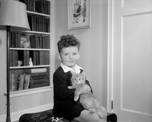 <table class=&quot;lightbox&quot;><tr><td colspan=2 class=&quot;lightbox-title&quot;>Boy Holding a Cat</td></tr><tr><td colspan=2 class=&quot;lightbox-caption&quot;>Photograph of a young boy in his home holding a cat, taken in 1948. </td></tr><tr><td colspan=2 class=&quot;lightbox-spacer&quot;></td></tr><tr class=&quot;lightbox-detail&quot;><td class=&quot;cell-title&quot;>Source: </td><td class=&quot;cell-value&quot;>From the James Blair Murdoch Photographs. Archives, University of Wisconsin-Milwaukee Libraries. <br /><a href=&quot;http://collections.lib.uwm.edu/digital/collection/jbmurdoch/id/1575/rec/41&quot; target=&quot;_blank&quot;>University of Wisconsin-Milwaukee Libraries</a></td></tr><tr class=&quot;filler-row&quot;><td colspan=2>&nbsp;</td></tr></table>