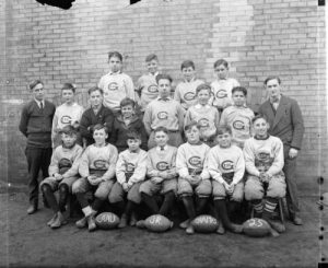Photograph of the 1925 CAAU Junior Champion Gesu Grade School football team.