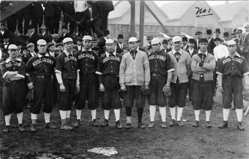 Photograph of the 1912 Kosciuszko Reds, a popular  baseball team gathered outdoors.