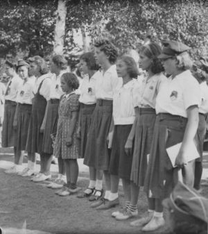 The letters ZNP on the insignia of these young women's uniforms indicate their membership in the Polish National Alliance scouting program.