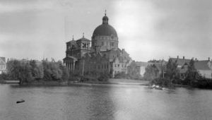 Photograph of the Basilica of St. Josaphat over the lagoon in Kosciuszko Park.