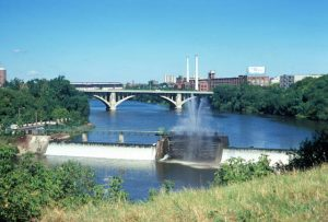 The North Avenue Dam, in place since 1891, was partially removed in 1994 and fully removed in 1997 to help improve the river's water quality. A pedestrian bridge is now in place near the former dam site, which connects the two sides of the RiverWalk.