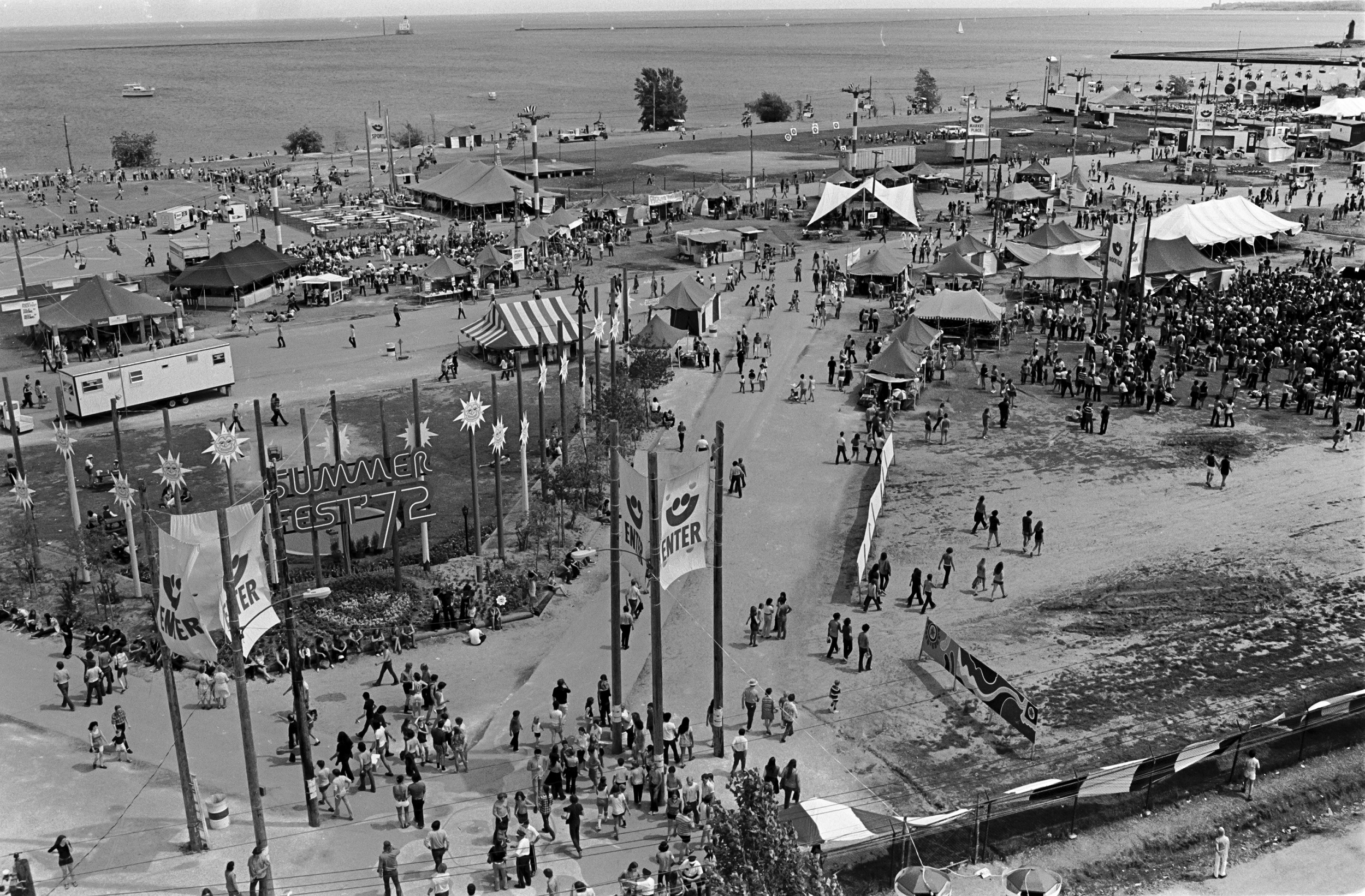 <table class=&quot;lightbox&quot;><tr><td colspan=2 class=&quot;lightbox-title&quot;>View of an Early Summerfest</td></tr><tr><td colspan=2 class=&quot;lightbox-caption&quot;>This photograph shows the Summerfest grounds as seen from on top the double ferris wheel at the midway, taken in 1972. </td></tr><tr><td colspan=2 class=&quot;lightbox-spacer&quot;></td></tr><tr class=&quot;lightbox-detail&quot;><td class=&quot;cell-title&quot;>Source: </td><td class=&quot;cell-value&quot;>Photograph by Alan Magayne-Roshak. Copyright 2013. Reprinted with permission. </td></tr><tr class=&quot;filler-row&quot;><td colspan=2>&nbsp;</td></tr></table>