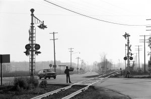Railroad tracks continue to criss-cross the Milwaukee area, as revealed in this 1975 photograph of the intersection of Brown Deer Road and Highway 100.