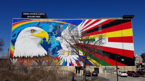 """Photograph of Esperanza Unida, or """"Mural of Peace,"""" painted by Reynaldo Hernandez on the side of a building on W. National Avenue in the Walker's Point neighborhood."""