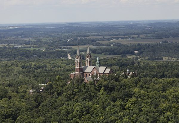 Aerial view of the Basilica of the National Shrine of Mary Help of Christians at Holy Hill, a popular destination for tourists and pilgrims.
