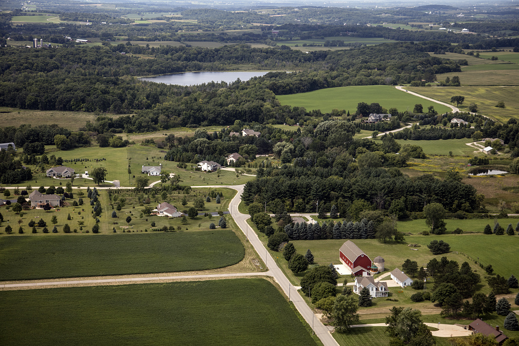 This 2016 photograph of the Town of Erin shows the combination of rural farms and modern housing that characterize its twenty-first century development.