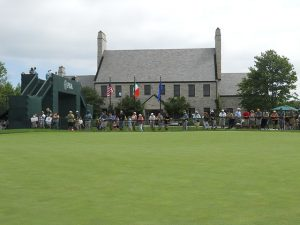 Photograph of the Whistling Straits clubhouse and spectators during the 2010 PGA Championship.