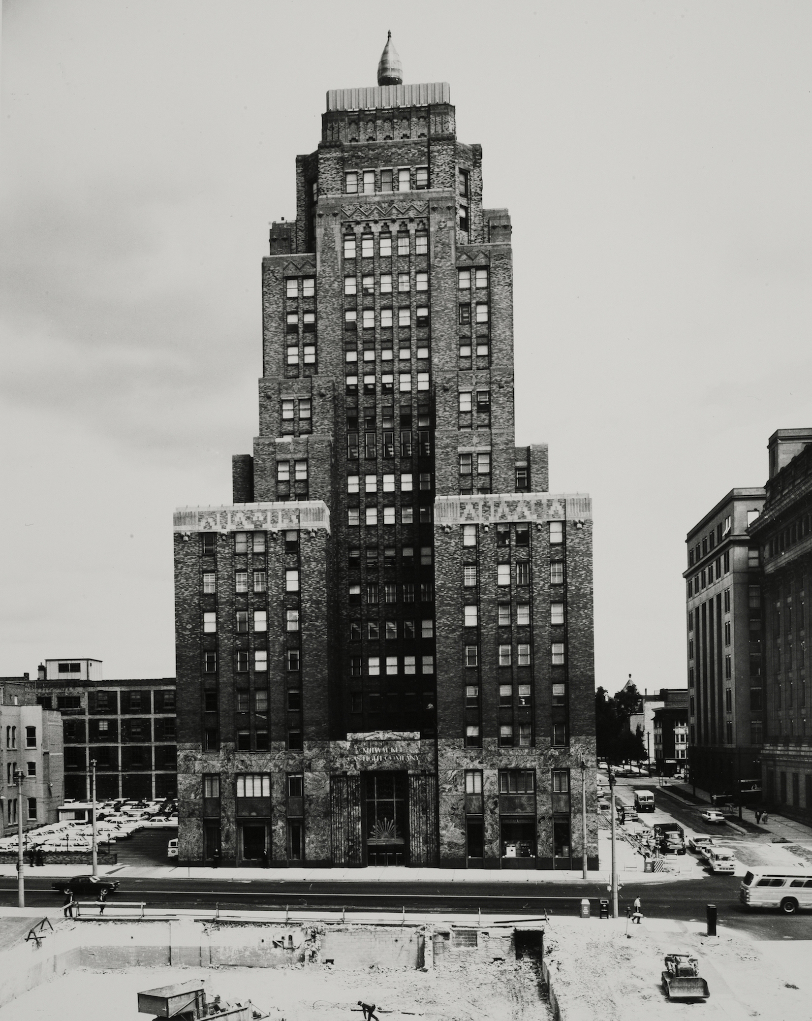 <table class=&quot;lightbox&quot;><tr><td colspan=2 class=&quot;lightbox-title&quot;>Wisconsin Gas Company Building</td></tr><tr><td colspan=2 class=&quot;lightbox-caption&quot;>This 1965 photograph of the Wisconsin Gas Building shows the flame atop the structure.</td></tr><tr><td colspan=2 class=&quot;lightbox-spacer&quot;></td></tr><tr class=&quot;lightbox-detail&quot;><td class=&quot;cell-title&quot;>Source: </td><td class=&quot;cell-value&quot;>Photograph by Alan Magayne-Roshak. Copyright 2013. Reprinted with permission.</td></tr><tr class=&quot;filler-row&quot;><td colspan=2>&nbsp;</td></tr></table>