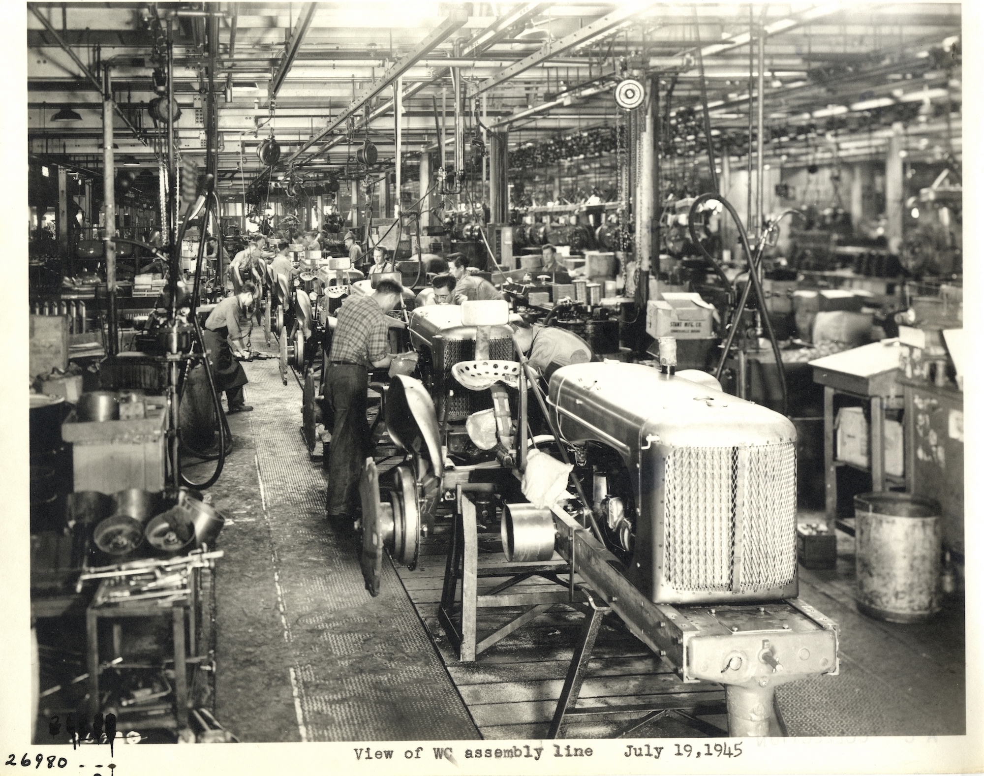 1945 photograph of Allis-Chalmers employees assembling WC model tractors in West Allis, highlighting the importance of both heavy manufacturing and agriculture in the Milwaukee area.
