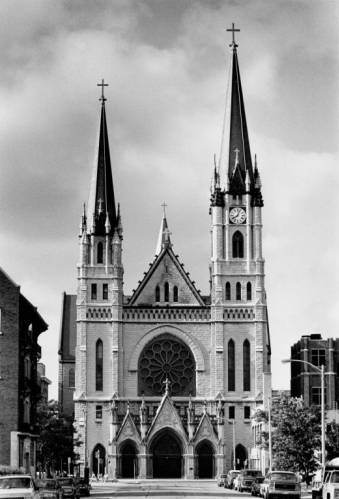 1991 photograph featuring the north facade of Gesu Church. Dedicated in 1894, its two towers are a unique feature to this landmark building.