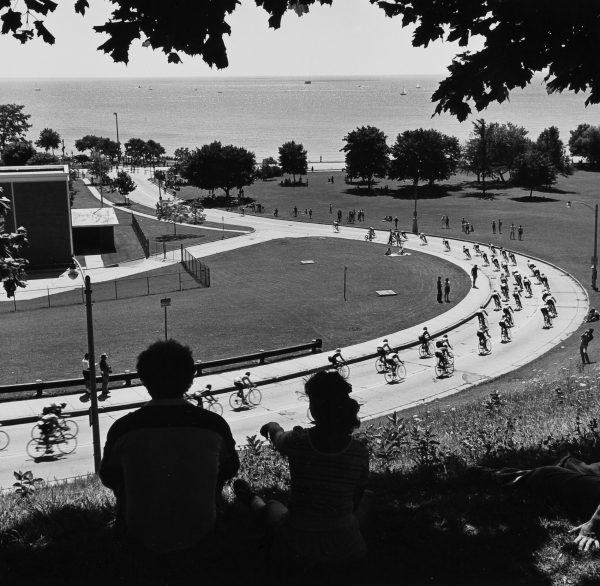 Bicycle racers head down the hill below the Northpoint Water Tower in 1982.