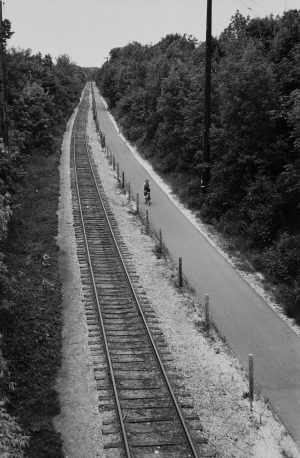 A bicyclist rides along the Oak Leaf trail on the east side near Locust Street in 1981.