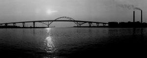 The rising sun illuminates the Hoan Bridge in this 1973 photograph.
