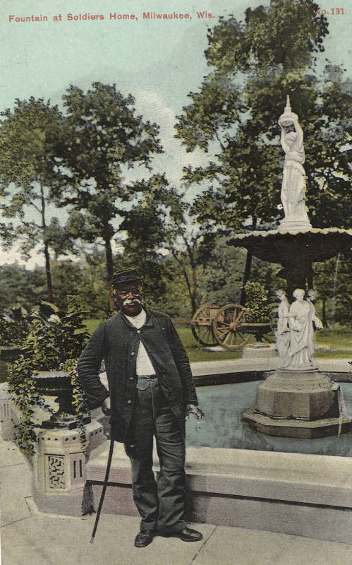 Postcard created between 1907 and 1915 featuring an African-American man by a fountain at the National Home for Disabled Volunteer Soldiers in Milwaukee.
