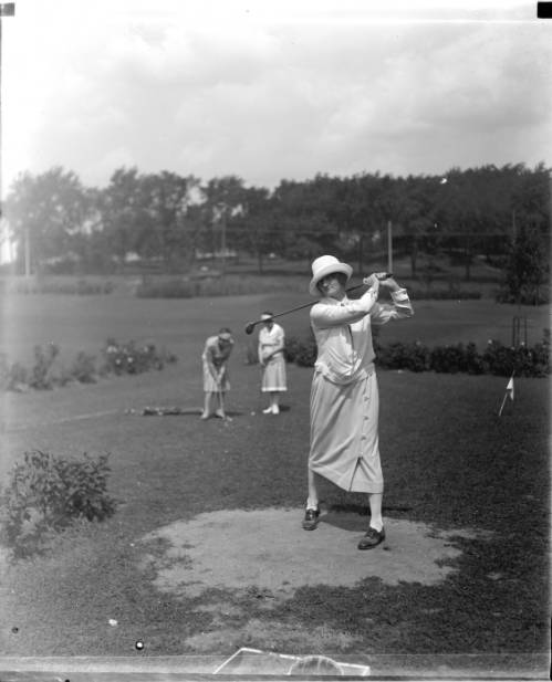 Three women golf on a Milwaukee course in the summer of 1925.