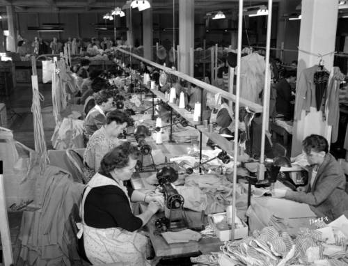 1945 photograph of women employed as garment workers at a factory located in the Mayer Building.