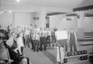 Photograph taken in 1943 of government service employees enjoying the game of bowling.