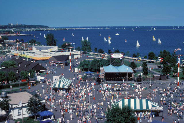 Photograph of crowds at Summerfest and sailboats on Lake Michigan, taken in 1982.