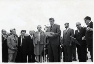 Photograph of Golda Meir and Mayor Henry Maier taken in 1969 on Meir's diplomatic visit to Milwaukee. Meir is seen just to the left of Maier, who is standing at the microphone.