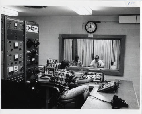 <table class=&quot;lightbox&quot;><tr><td colspan=2 class=&quot;lightbox-title&quot;>WUWM Broadcast Booth</td></tr><tr><td colspan=2 class=&quot;lightbox-caption&quot;>Photograph showcasing the radio booth and production of a WUWM broadcast, taken between 1978 and 1980. </td></tr><tr><td colspan=2 class=&quot;lightbox-spacer&quot;></td></tr><tr class=&quot;lightbox-detail&quot;><td class=&quot;cell-title&quot;>Source: </td><td class=&quot;cell-value&quot;>From the UW-Milwaukee Photographs Collection. Archives, University of Wisconsin-Milwaukee.</td></tr><tr class=&quot;filler-row&quot;><td colspan=2>&nbsp;</td></tr></table>