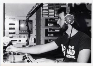 Photograph of WUWM radio engineer Bruce Winter working in the broadcast booth, taken between 1978 and 1980.