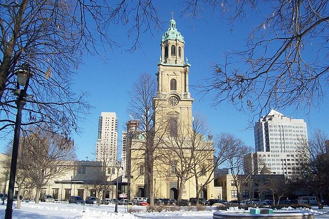 Photograph of the Cathedral of St. John the Evangelist as seen from across Cathedral Square Park.