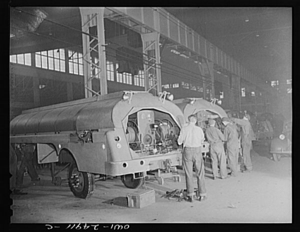 1943 photograph of Heil Company war production employees making gasoline tanker trucks.