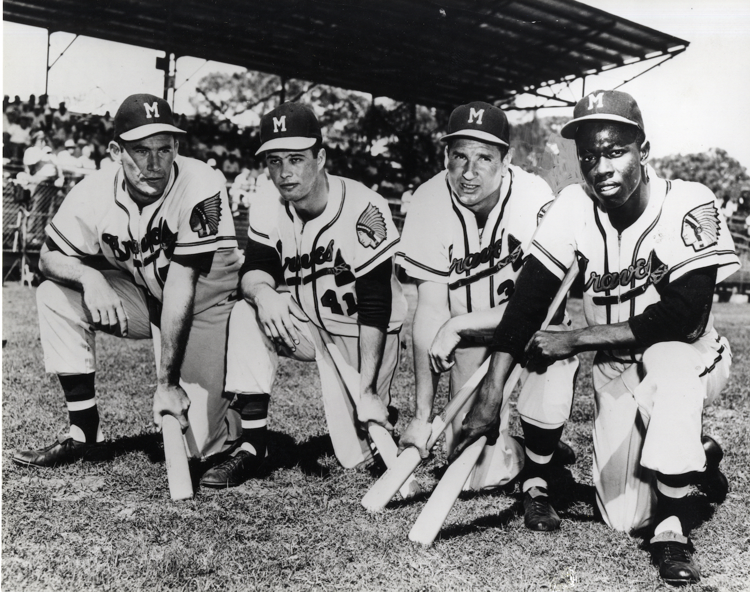 Photograph featuring, from left to right, Joe Adcock, Eddie Mathews, Bobby Thomson, and Hank Aaron of the 1957 Braves at spring training.