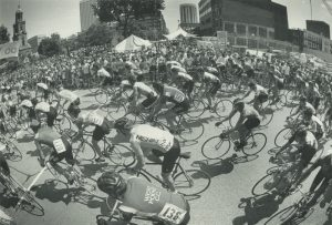 A large crowd watches as people participate in the Bastille Days bike race in 1983.