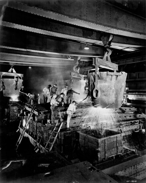 Employees work with molten metal at Falk Corporation in 1963.