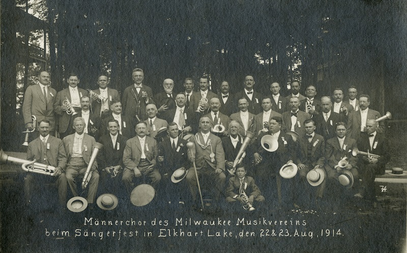 <table class=&quot;lightbox&quot;><tr><td colspan=2 class=&quot;lightbox-title&quot;>Milwaukee Musikverein</td></tr><tr><td colspan=2 class=&quot;lightbox-caption&quot;>August 1914 photograph of the men's chorus of the Milwaukee Musikverein at a song festival in Elkhart Lake. With the outbreak of World War I in August of 1914, the German-American community would soon face discrimination and be forced to prove their loyalty once the U.S. entered the war in April 1917.</td></tr><tr><td colspan=2 class=&quot;lightbox-spacer&quot;></td></tr><tr class=&quot;lightbox-detail&quot;><td class=&quot;cell-title&quot;>Source: </td><td class=&quot;cell-value&quot;>From the Historic Photo Archive of the Milwaukee Public Library. Reprinted with permission. <br /><a href=&quot;http://content.mpl.org/cdm/singleitem/collection/HstoricPho/id/5185/rec/67&quot; target=&quot;_blank&quot;>Milwaukee Public Library</a></td></tr><tr class=&quot;filler-row&quot;><td colspan=2>&nbsp;</td></tr></table>