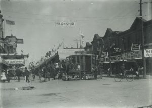 Early 20th century photograph featuring some of the shops and stands inside the Jahrmarkt, highlighting the connections between German culture and business in Milwaukee.