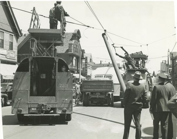 A team of men, some from the Milwaukee Electric Railway & Light Company and some employed by the Works Progress Administration, work to repair power lines on North Avenue.