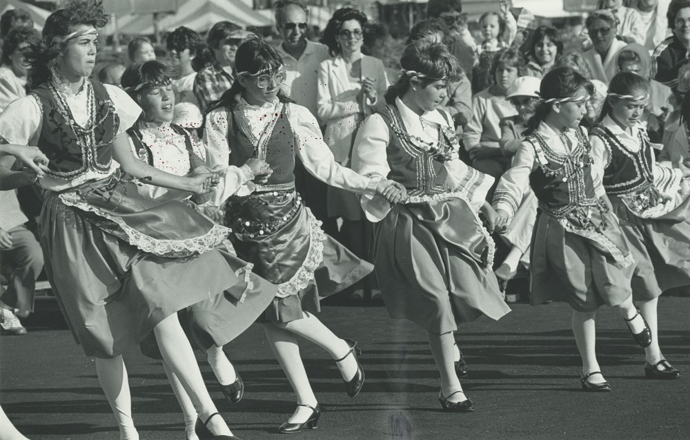 <table class=&quot;lightbox&quot;><tr><td colspan=2 class=&quot;lightbox-title&quot;>Greek Fest Dancers</td></tr><tr><td colspan=2 class=&quot;lightbox-caption&quot;>A group of six girls in traditional costumes dance at Greek Fest in 1984. Greek Fest is hosted by the Greek Orthodox Church of the Annunciation to celebrate Greek culture and community in Milwaukee. </td></tr><tr><td colspan=2 class=&quot;lightbox-spacer&quot;></td></tr><tr class=&quot;lightbox-detail&quot;><td class=&quot;cell-title&quot;>Source: </td><td class=&quot;cell-value&quot;>From the Historic Photo Archive of the Milwaukee Public Library. Reprinted with permission. <br /><a href=&quot;http://content.mpl.org/cdm/singleitem/collection/HstoricPho/id/5675/rec/1&quot; target=&quot;_blank&quot;>Milwaukee Public Library</a></td></tr><tr class=&quot;filler-row&quot;><td colspan=2>&nbsp;</td></tr></table>