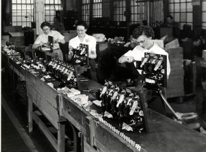 Photograph of women assembling small engines for the Allis-Chalmers Corporation.