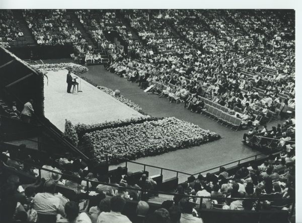 A large audience listens to a speaker at the 1978 National Jehovah's Witnesses Convention, held in the MECCA Arena, now known as the Milwaukee Arena.