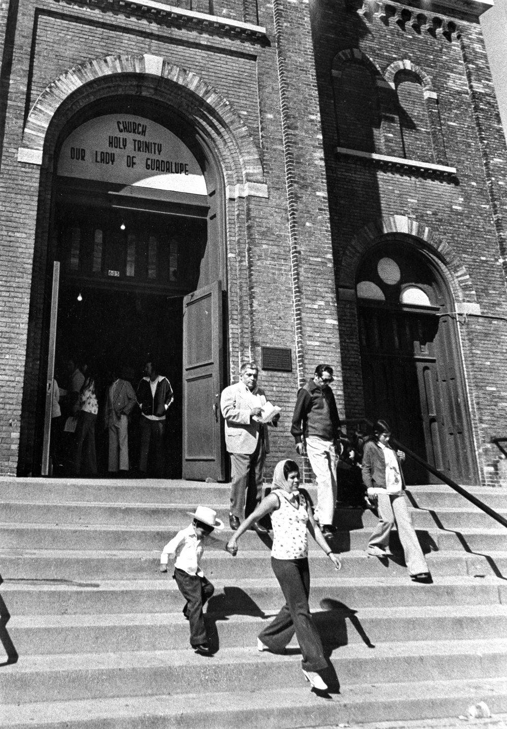 A group of parishioners exit Our Lady of Guadalupe after mass in 1975.