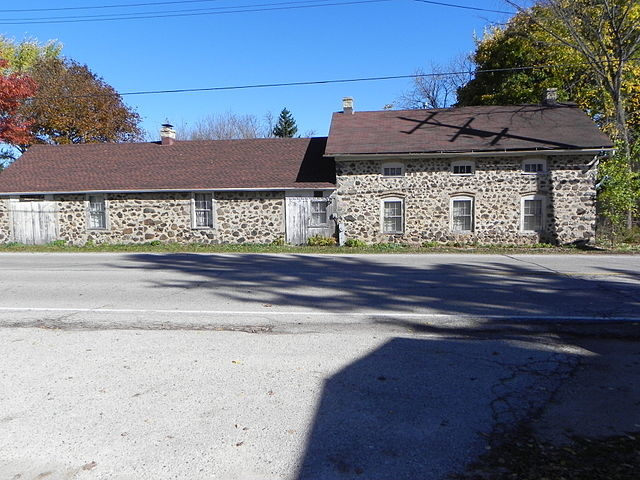 This 2014 photograph shows the nineteenth century Ritger Wagonmaking and Blacksmith Shop in its modern context.