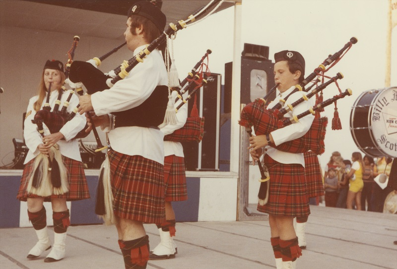 1973 photograph of the Billy Mitchell Scottish Pipe Band performing at Summerfest, showcasing the historic connection between Milwaukee's Scottish community and modern culture.