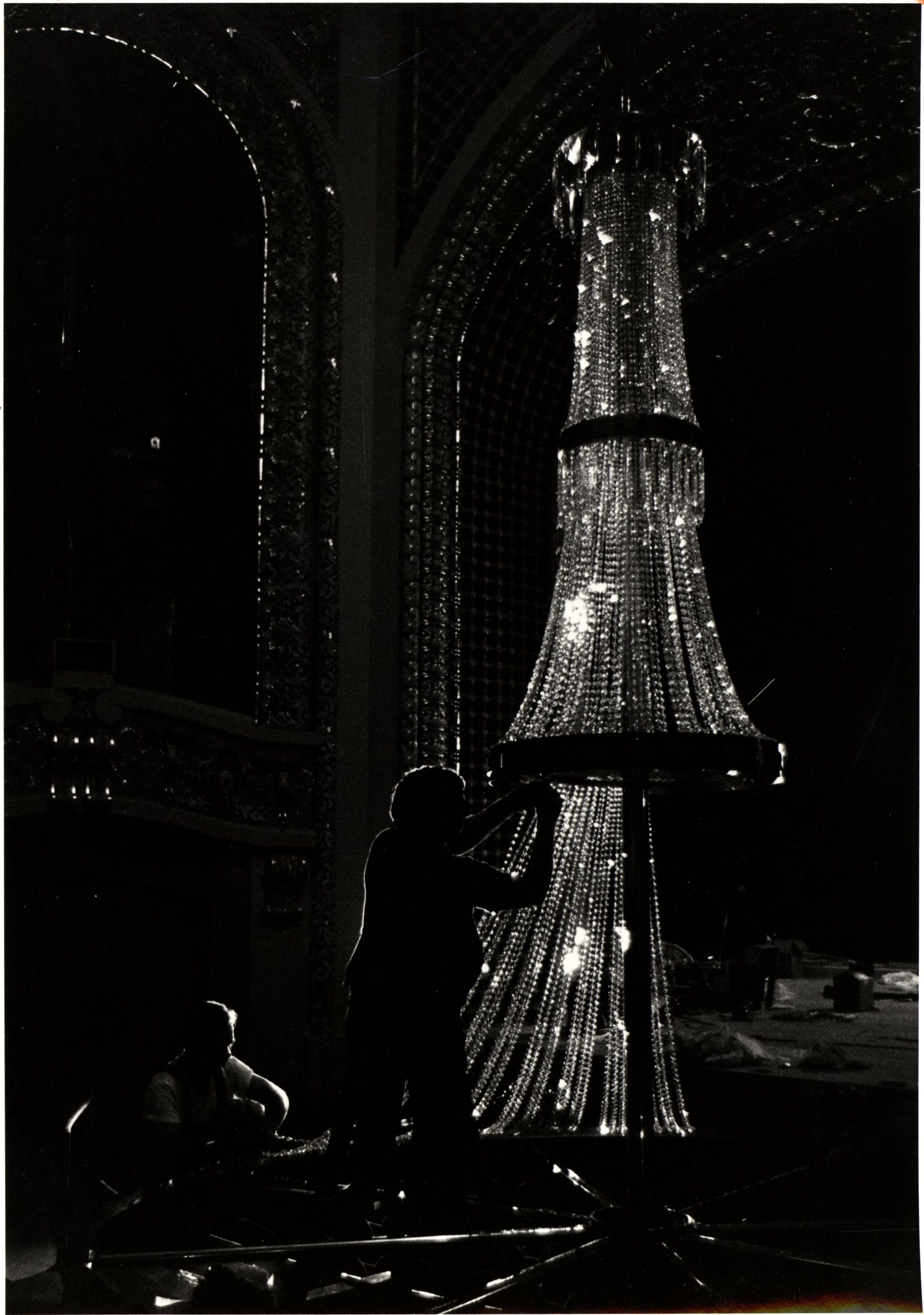 Hand stringing 33,000 inches of Austrian lead crystal for a chandelier in the Pabst Theater.