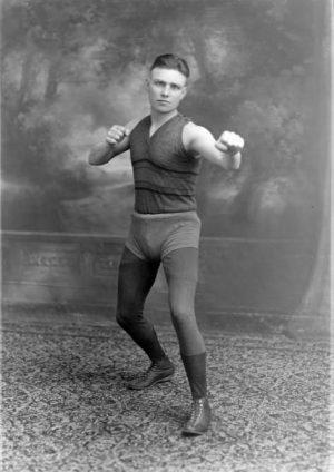 """Portrait of Milwaukee boxer Anton Chmurski, known as """"Kid Moore,"""" taken in 1920."""
